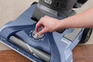 a vacuum should have a manual or automatic Vacuum Head or Nozzle Height Adjustment to work well on carpet and hardwood floors