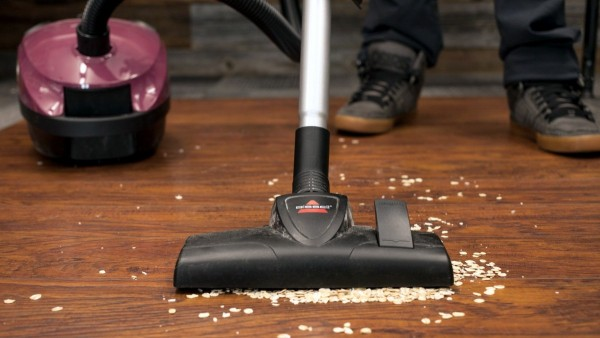 large debris gets pushed along on hardwood floors by most vacuum cleaners