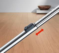 a button allows you to adjust length of the stainless steel wand