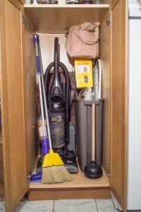 corded upright vacuum lurking in closet